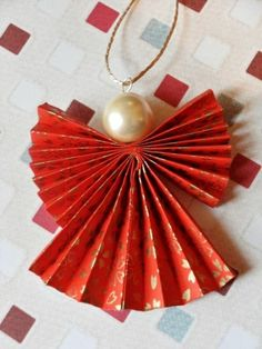 Christmas DIY: Origami Christmas An Origami Christmas Angel Decoration in Red an. Christmas DIY: Origami Christmas An Origami Christmas Angel Decoration in Red and Gold Christmas Angel Decorations, Christmas Angel Ornaments, White Christmas Trees, Beautiful Christmas, Christmas Poinsettia, Christmas Origami, Christmas Crafts, Christmas Ideas, Crochet Christmas