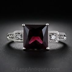 This striking and distinctive ring features a deep burgundy color scissor-cut garnet weighing carats. The gemstone is tastefully presented in a bright white gold mounting enlivened with eight tiny full-cut diamonds set delicately milgrained settings. Vintage Stil, Style Vintage, Vintage Rings, Vintage Fashion, Garnet And Diamond Ring, Diamond Gemstone, Diamond Cuts, Garnet Rings, Diamond Rings