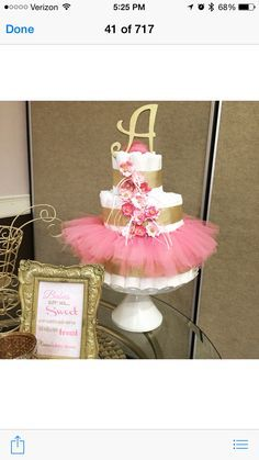 Pink and gold diaper cake