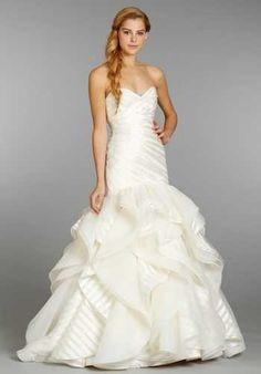 Ivory strapless striped organza bridal gown with a ruched elongated bodice, flounced tulle and organ
