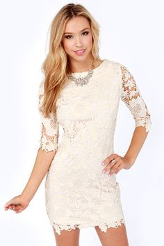 6ace9cbccd A rounded neckline proves a beautiful beginning to this floral crocheted  lace dress