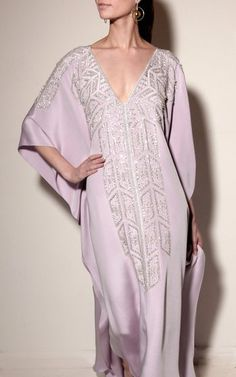 This **Joanna Mastroianni** Reversible Embroidered Art Deco Caftan features a boat or v-neckline, depending on which way it is worn, with wide flowing sleeves and a maxi length bodice. Abaya Fashion, Muslim Fashion, Steampunk Fashion, Gothic Fashion, Kaftan Designs, Mode Abaya, Caftan Dress, Simple Dresses, Scarf Styles