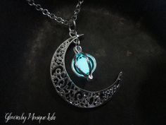 """Crescent moon with matching silver plated glowing orb cage with glow glass. Handmade in smoke free studio. The original Glow Lockets ® handmade by Monique Lula. One of my original designs inspired by the glowing magical orbs and the moon. Just wear in sunlight, will glow in the dark. Moon measures 1.5 inches and chain is 20"""" Delicately and professionally handmade by Monique Lula in my smoke free jewelry studio in California, USA! The little glowies store that started the whole trend! Ad..."""