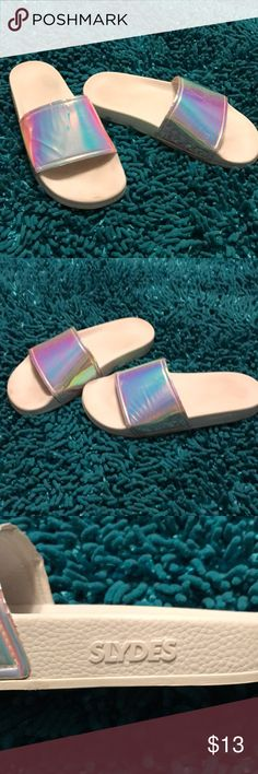 SLYDES IRIDESCENT SLYDES . I've wore around house and few times outside. They have scratches on top of one as shown in pictures. SLYDES Shoes Sandals