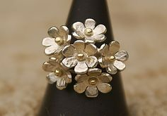 Google Image Result for http://www.lesleysdesigns.co.uk/for%20web%20page/silver%20flower%20ring.jpg