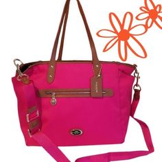 """Coach fuschia canvas diaper/overnight bag NWT Fuschia Sawyer canvas diaper bag with leather trim and top zipper closure, outside zip pocket and 2 side gusset pockets, goldtone hardware. One interior zip pocket, 2 slot pockets, removable black changing pad. Approx 19L top, 15L base x 12 H x 7.5 W,  9.5"""" handles, 21.5 adjustable crossbody strap. ALSO perfect for an overnight bag! (Photos by Amazon.com) Coach Bags Baby Bags"""
