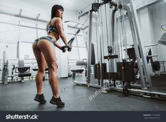 https://image.shutterstock.com/z/stock-photo-sexy-athlete-woman-posing-with-simulator-in-the-gym-277106465.jpg
