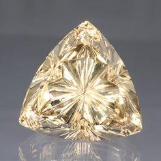 Golden Beryl Starbrite™ Cut 79.29 carats Length x width: 27.4 mm Pavilion depth: 12.9 mm Total depth: 17.1 mm Primary color: Yellow Shape: Triangle/Trillion Origin: Brazil