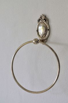 A classic design towel ring with a smaller than standard size ring, suitable for small towels, guest towels, hand towels and even scarves. - Size – (ring diameter) - Silver plated on brass - Made in India - Imported by Masquerade Guest Towels, Hand Towels, Towel Rings, Masquerade, Size 16, Hooks, Silver Plate, Plating, Scarves