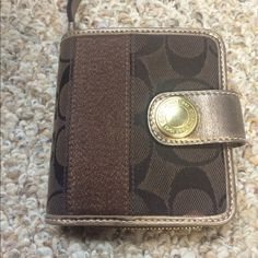 Coach Wallet - Chocolate Brown! *Like new!* 'Like New' Coach Wallet! 100% authentic - Perfect size for a lot of spare change and a lot of cards! Chocolate brown coloring w/ a slight golden shimmer. Great for any time of the year! Offers accepted. Open to bundle for 20% off. Coach Bags Wallets