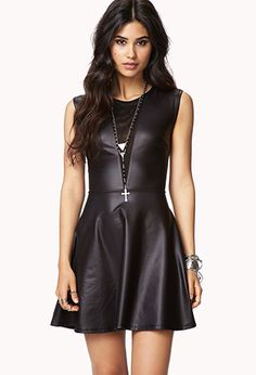 A faux leather skater dress featuring mesh trim. Round neckline. Sleeveless. Semi-sheer. Unlined. Knit. Lightweight.