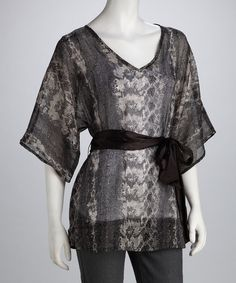 Kimono-inspired with wide sleeves and a sash at the waist, this cover-up hits all the stylish high notes. Soft fabric and a vibrant gray and white pattern add artistic appeal to any day.Measurements (size M): 31'' long from high point of shoulder to hem100% polyesterHand wash; hang dry