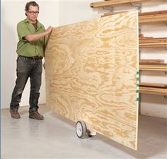 Sheet Goods Caddy by American Woodworker Editors -- Homemade sheet goods caddy constructed from lawnmower wheels, plywood, bolts, nylon bushings, washers, and locking knobs. http://www.homemadetools.net/homemade-sheet-goods-caddy