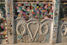 Detail of one of the 17 structures of the Watts Tower in Los Angeles built by Simon Rodia in his spare time over a period of 33 years with much recycled material.