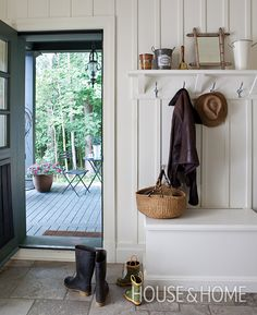No doubt about it, entryways and mudrooms can get, well, muddy. Embrace the boot tray | Photographer:  André Rider  Designer:  Daniel Brisset