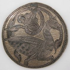 Roundel with a Griffin. Date: ca. 1175–1200 Geography: Made in Rhine valley, Germany or England Culture: British or German Medium: Gilded silver inlaid with niello