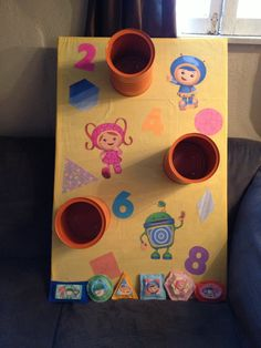 Made a bean bag toss game for my daughter's Team Umizoomi party using old coffee cans and felt for the bean bags