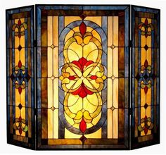 There's something calm about geometric, don't you think? Tiffany style stained glass fireplace screen
