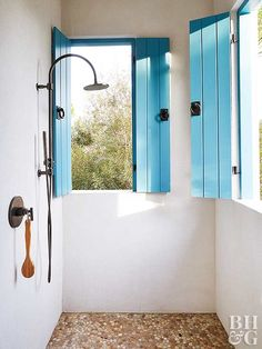 southwestern decor outdoor shower with blue shutters