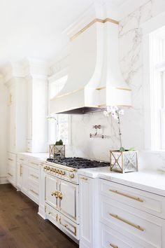 Alyssa Rosenheck   Laura Burleson Interiors   White And Gold Kitchen  Features White Cabinets Adorned With Long Gold Pulls Paired With Silestone  Countertops ...