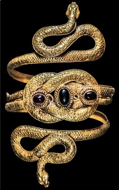 Gold and Garnet Snake Bracelet with Heracles Knot, 4th Century BC - 1st Century ADSnake jewelry was among the more popular luxury items in the Greek and Roman civilizations, including in the Greek colonies which flourished around the Black Sea. Extensive trade with these settlements spread Greek art, and its influence, across much of Eurasia. Some styles were copied so closely that it can be difficult, if not impossible, to be certain who crafted an item.[[MORE]]One unusual feature of the…