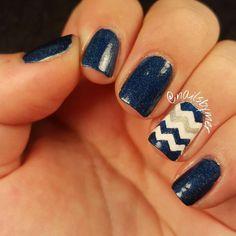 "I'm in a blue chevron kind of mood today. What's your mood like?  Polish Used: @nativewarpaints ""Officer Handsome"" (blue) @sinfulcolors_official ""Snow Me White"" (white) @julepmaven ""Tin Man"" (silver) @sechenails Vite Dry Fast Top Coat  #nails #nail #nailart #nailartfun #nailartlove #nailartwow #funnails #mani #manicure #prettynails #prettyfingers #craftynails #nailstgram #nailsofinstagram #nailsofig #nailswag #funnails #funmani #nailsbymer #nails2inspire #nailartohlala #nailartpromote…"