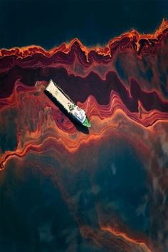 Aerial view of an oil spill- ironic beauty of a disaster. Colour scheme and layers. Spill out towards audience? Layers of colour & texture. Concrete grey- industrial, earth colour- layers of earth exposed to fracking, red- blood of murder Ocean Pollution, Oil Industry, Oil Spill, Ap Art, Environmental Issues, Aerial View, Mother Earth, Art Projects, Art Photography