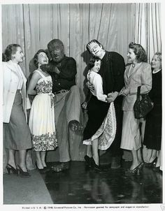 "Frankenstein (Glenn Strange) and The Wolf Man (Lon Chaney, Jr.) find a couple of girls to dance with during the production of ""Abbott and Costello Meet Frankenstein"" 1948"