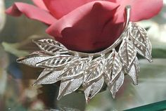 Hey, I found this really awesome Etsy listing at https://www.etsy.com/listing/246541649/1940s-coro-brooch-leaf-brooch-antique