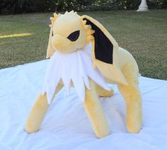 This life size, squishy and cool plushy is the number 135 in the National Dex, and has been roaming around uncaught waiting for the right trainer!  If able to stand, s/he is approx. 22 inches high (top of head,) 15in from chest to butt, and 7in wide. Made from my own custom pattern with Minky to be soft to the touch, flannel under the frill and satin for details, filled with fiberfill.