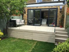Millboard composite decking and elite balustrade garden ideas in