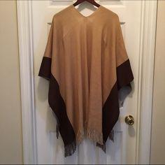 NWOT Open front poncho/shawl Open front poncho/shawl. NWOT. Fringed bottom. Never worn! Christopher & Banks Sweaters Shrugs & Ponchos