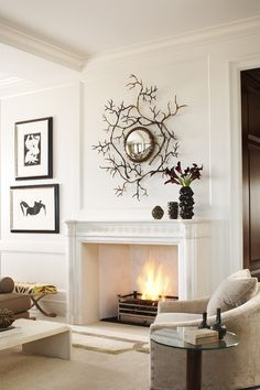 Branches over mantle.  Great family room décor.  Holidays, DIY, I see them painted or with harvest leaves, even jingle bells.  Any other ideas. Great family project for a Saturday.