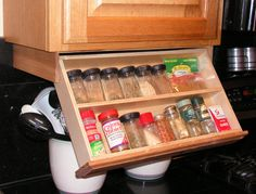 Genius, made to order on Etsy: By adding this drawer underneath your upper cabinet you will create more storage space in side your cabinets, or