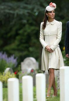 A solemn Kate walks past the graves of fallen soldiers. | http://aol.it/1pUnfW8 via @stylelist