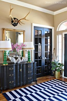 Love the rack, mirror, the black doors, and the beige/brown wall color.