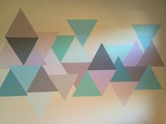 Ta dah!  The finished product - geometric triangle nursery wall in pastels, pink, purple, aqua, blue green and grey..