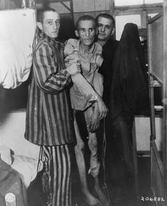 Inmates of the concentration camp at Flossenburg after being liberated by the 97th Infantry Division of the U.S. Army in May 1945. The emaciated prisoner in the center is a 23 year-old Czech ill with dysentery.
