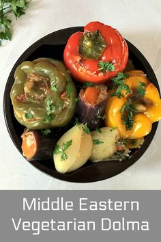 Middle Eastern vegetarian dolma or stuffed vegetables: peppers, aubergines (eggplant) and onions, a fantastic dish to feed the whole family. Vegetable Dishes, Vegetable Recipes, Meat Recipes, Real Food Recipes, Dinner Recipes, Delicious Vegan Recipes, Vegetarian Recipes, Healthy Recipes, Healthy Meals