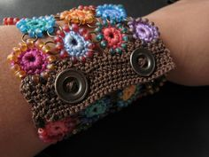 crochet bracelet love the colors. I can see this would be unique pair of finger less gloves with antique glass buttons!