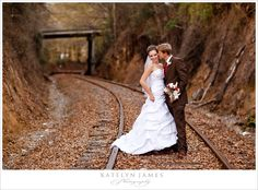 beautiful fall wedding; I wonder if we could manage a train track photo. Joe loves trains so much.