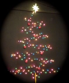 Christmas tree on wall in youth building.  Decided to do something different and it turned out fun.  Simply strung lights on the wall in zigzag pattern with star on top.