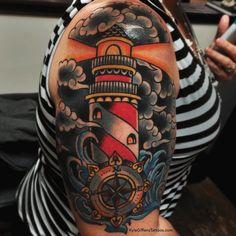 Nautical Compass And Lighthouse Tattoo On Sleeve