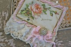 Ah...so shabby chic.  Lovely postcard with roses and lace in all the right colors.  Love this one!