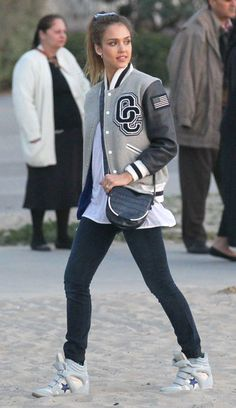 : Get sporty-chic inspiration from Jessicas park date style: an Opening Ceremony varsity jacket, wedge Isabel Marant sneakers, and a navy Vince Camuto crossbody.