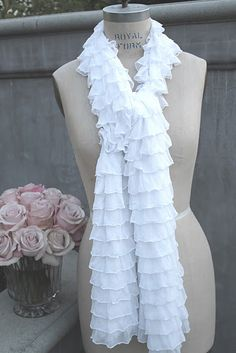 Oh, Oh, OH! Whisper Ruffle Scarves! I think my love for ruffles just kicked into overdrive! They are 15x72, so you can wear them any which way you like.  Fabric content: Nylon, Viscose, Several Colors @ 52.00 ea. Any one want to try a DIY? Let me know. :)