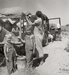 "August 1936. ""Part of an impoverished family of nine on a New Mexico highway. By Dorothea Lange"