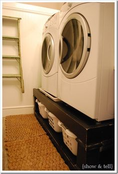 Love the DIY washer/dryer risers with laundry basket storage and the hanging bar above