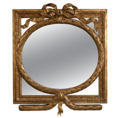 French Giltwood Mirror  France  1950's  A stunning and highly decorative wood in gold with ribbon bow.