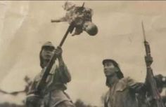 Japanese soldiers bayoneting a 3 year-old Chinese baby during 'The Rape of Nanking' - c. 1937-38